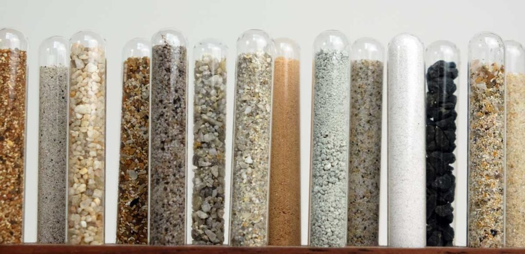 Close up of test tubes filled with sand from Western Australia