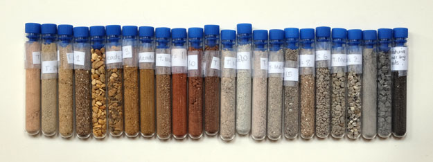 Test tubes filled with different coloured sands. Bristol