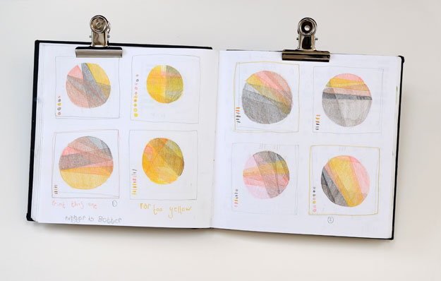 Sketchboook page of circular composition ideas for geological prints